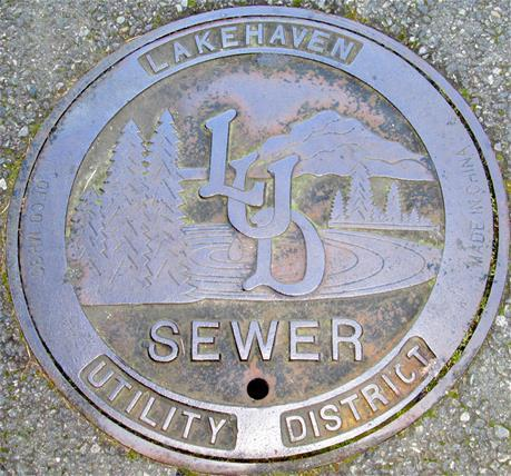 03_LUD imprinted sewer man hole close-up