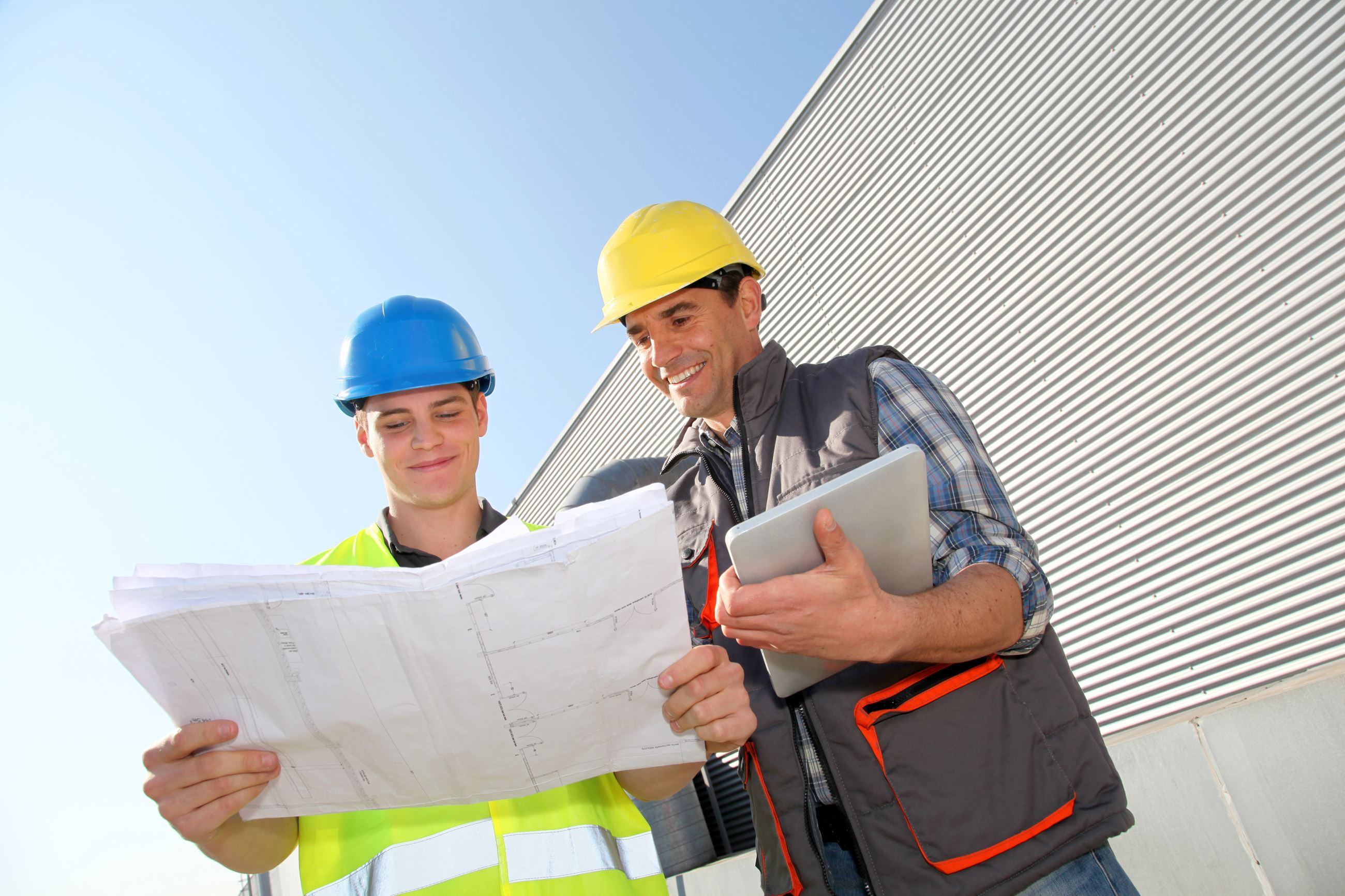 Internship Program 2 workers with hard hats consulting